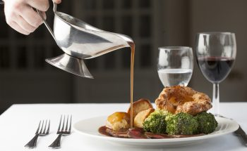 gravy pouring on sunday roast